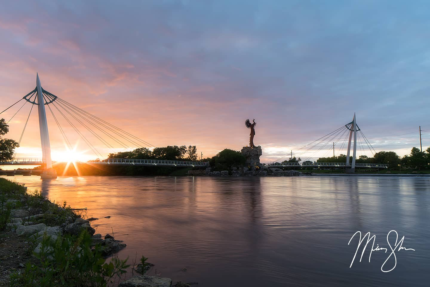 Open edition fine art print of Brilliant Sunburst Sunset at the Keeper of the Plains from Mickey Shannon Photography. Location: Keeper of the Plains, Wichita, Kansas