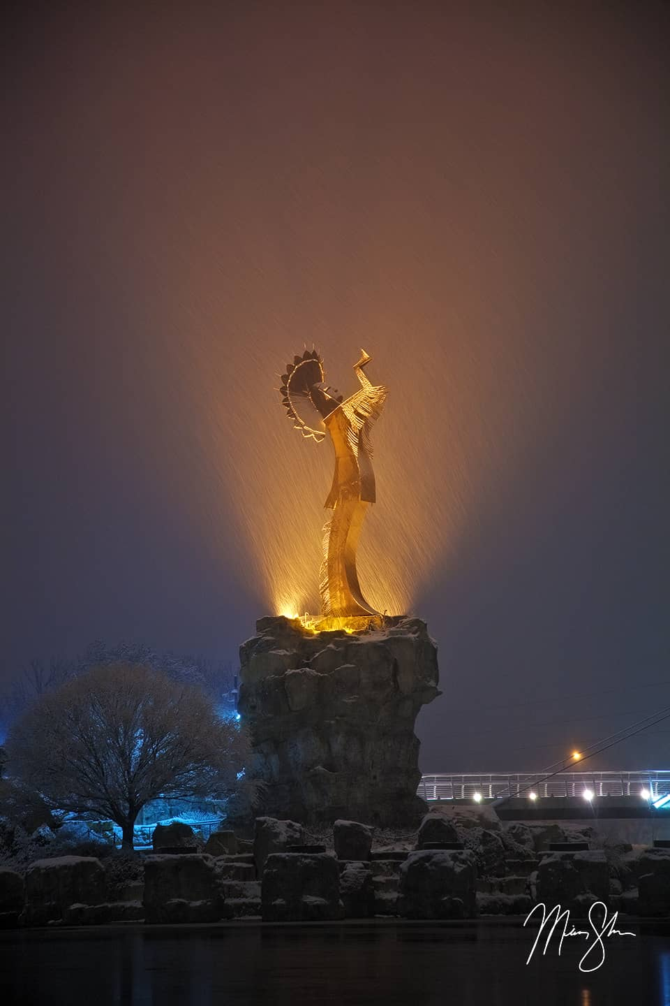 Open edition fine art print of Keeper of the Plains Winter Illumination from Mickey Shannon Photography. Location: Keeper of the Plains, Wichita, KS