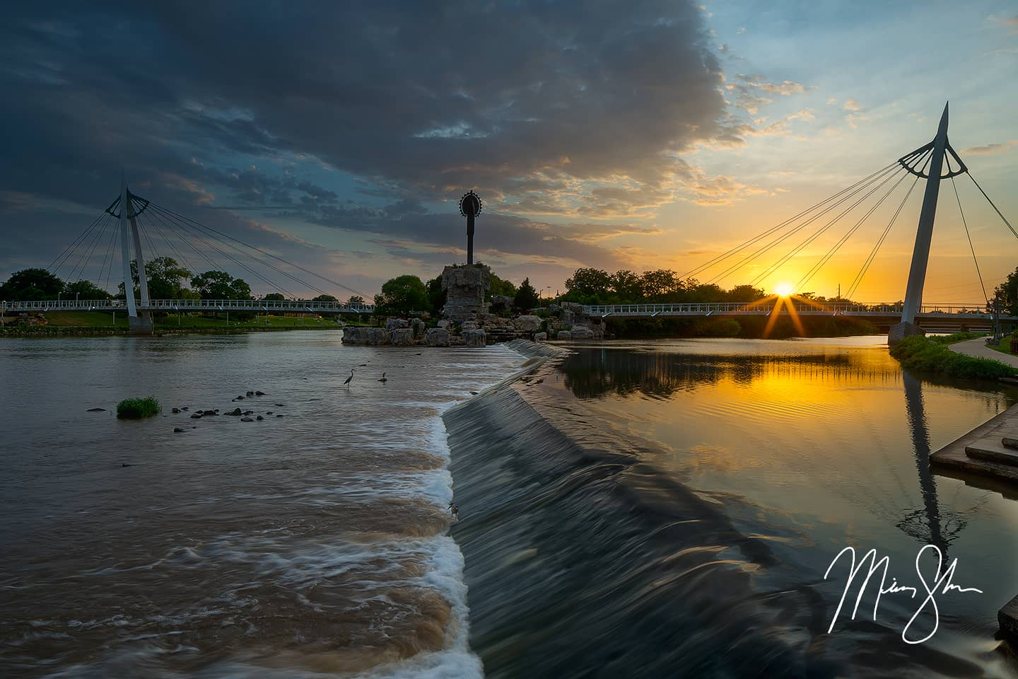 Open edition fine art print of Starburst Sunset at the Keeper of the Plains from Mickey Shannon Photography. Location: The Keeper of the Plains, Wichita, Kansas