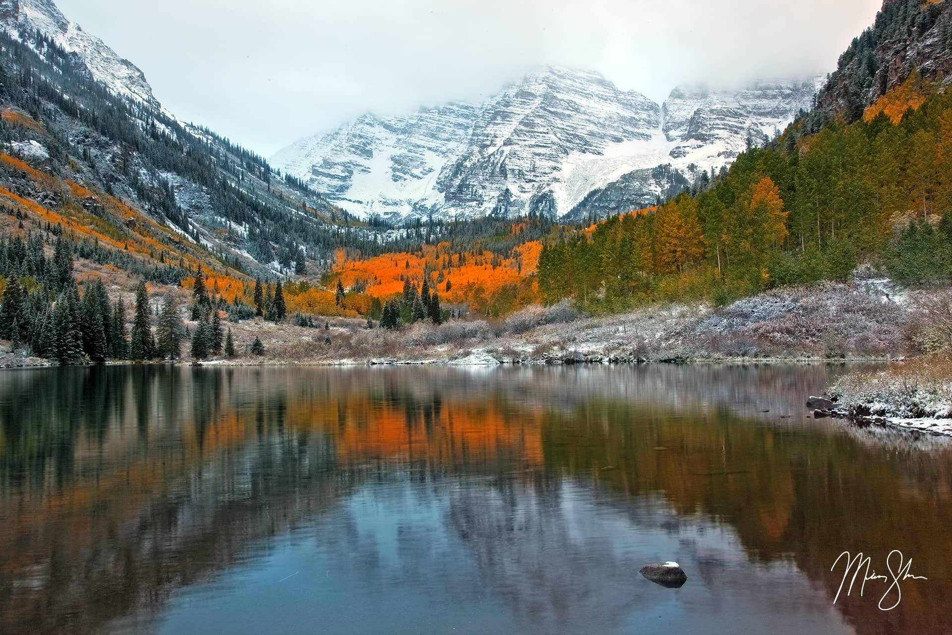 Open edition fine art print of Autumn and Winter Collide at the Maroon Bells from Mickey Shannon Photography. Location: Maroon Lake, Maroon Bells, Aspen, Colorado
